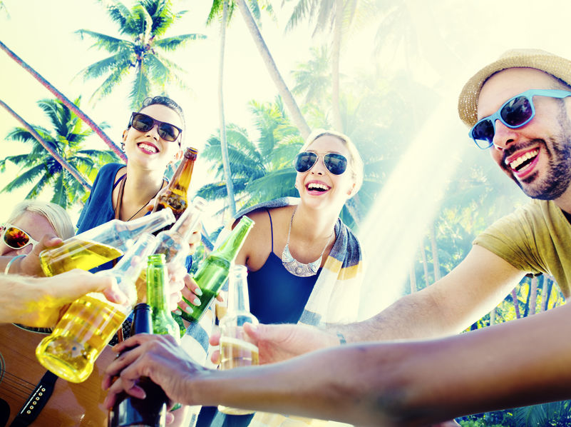 46139610 - friends summer beach party cheers concept