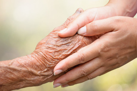37935229 - senior and young holding hands