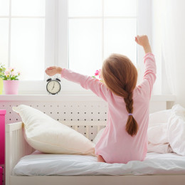 52899629 - a nice child girl enjoys sunny morning. good morning at home. child girl wakes up from sleep.